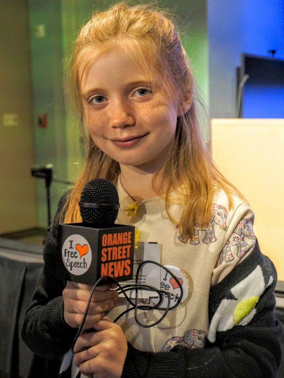 Hilde Lysiak poses with an Orange Street News mic.