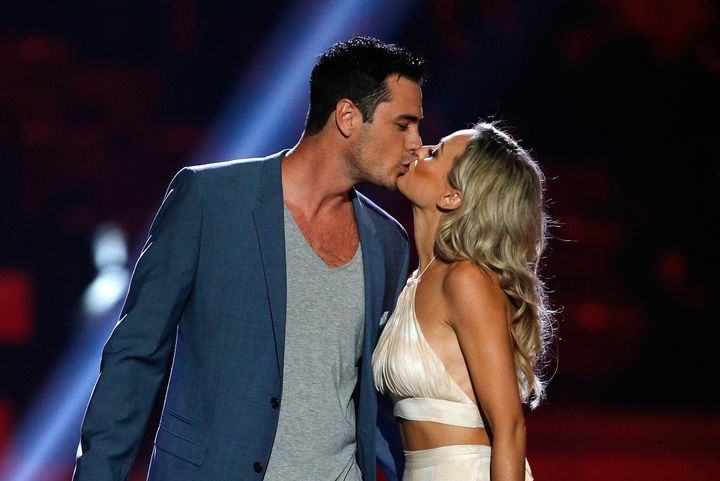 Ben Higgins and Lauren Bushnell show a little love at the iHeartCountry Festival in April.