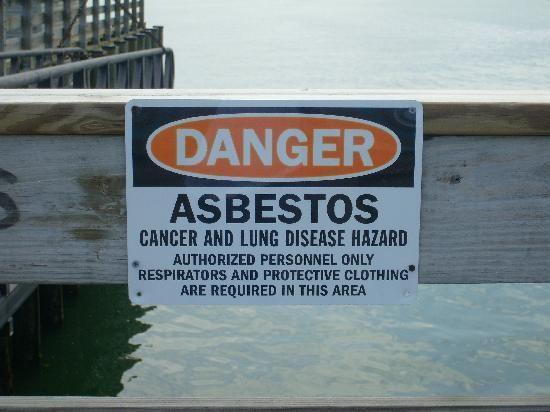 Asbestos warning sign at Peddock's Harbor in Boston, Massachusetts.