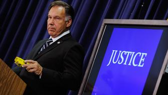 SANTA ANA , CA - SEPTEMBER 21:  Orange County District Attorney Tony Rackauckas holds a taser gun as a prop during a news conference to announce that two Fullerton, California police officers were charged in connection with the death of  Kelly Thomas, a schizophrenic homeless man who died after the altercation with several police officers, on September 21, 2011 in Santa Ana, California. Officer Manuel Ramos was charged with second-degree murder and involuntary manslaughter, while Cpl. Jay Cicinelli was charged with involuntary manslaughter and use of excessive force.  (Photo by Kevork Djansezian/Getty Images)