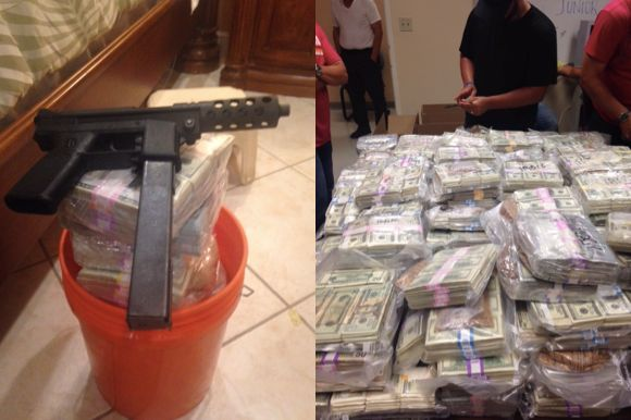 Authorities say in addition to the money they recovered this high-powered gun while raiding the Miami home.