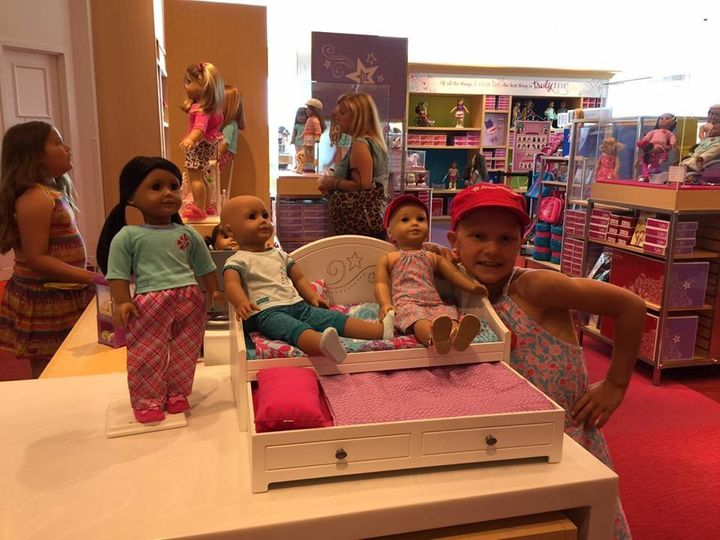 """Mia was """"ecstatic"""" to see bald American Girl dolls on display at the store."""