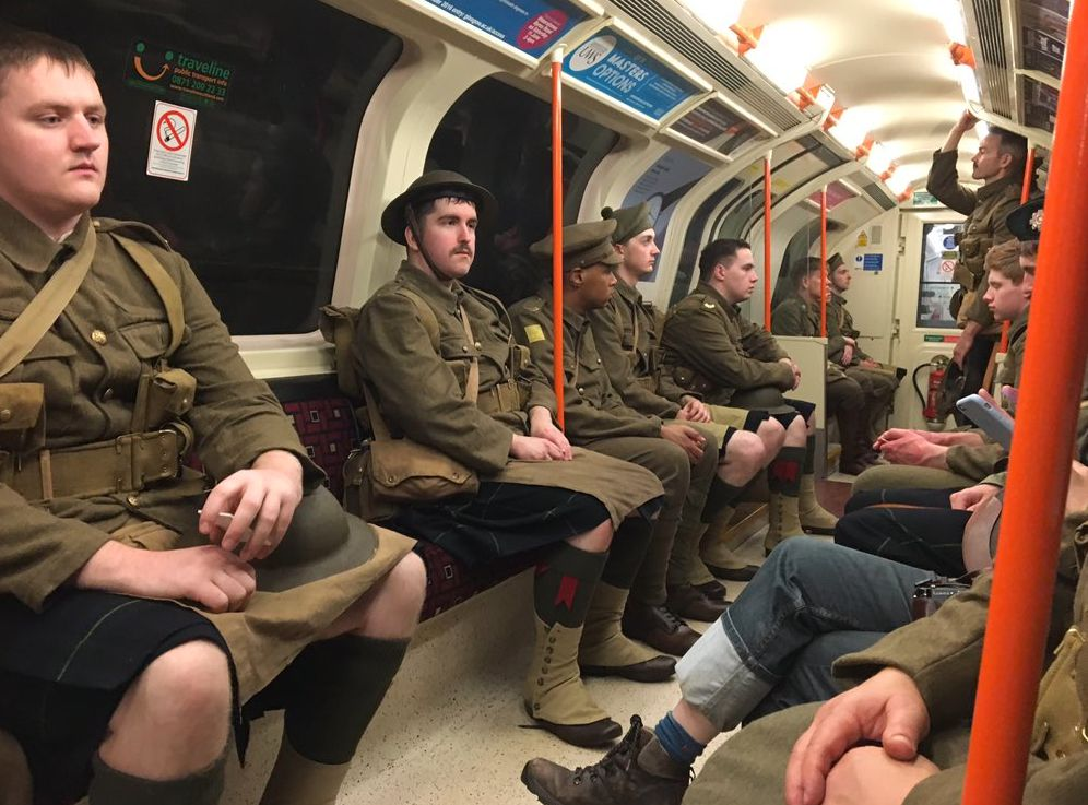 Chilling And Sobering Start For Commuters As Soldiers Sing We Are Here At Train