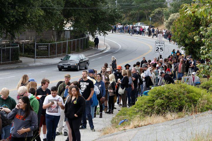 People wait in line to attend a campaign rally for Democratic U.S. presidential candidate Bernie Sanders in Santa Cruz, Calif