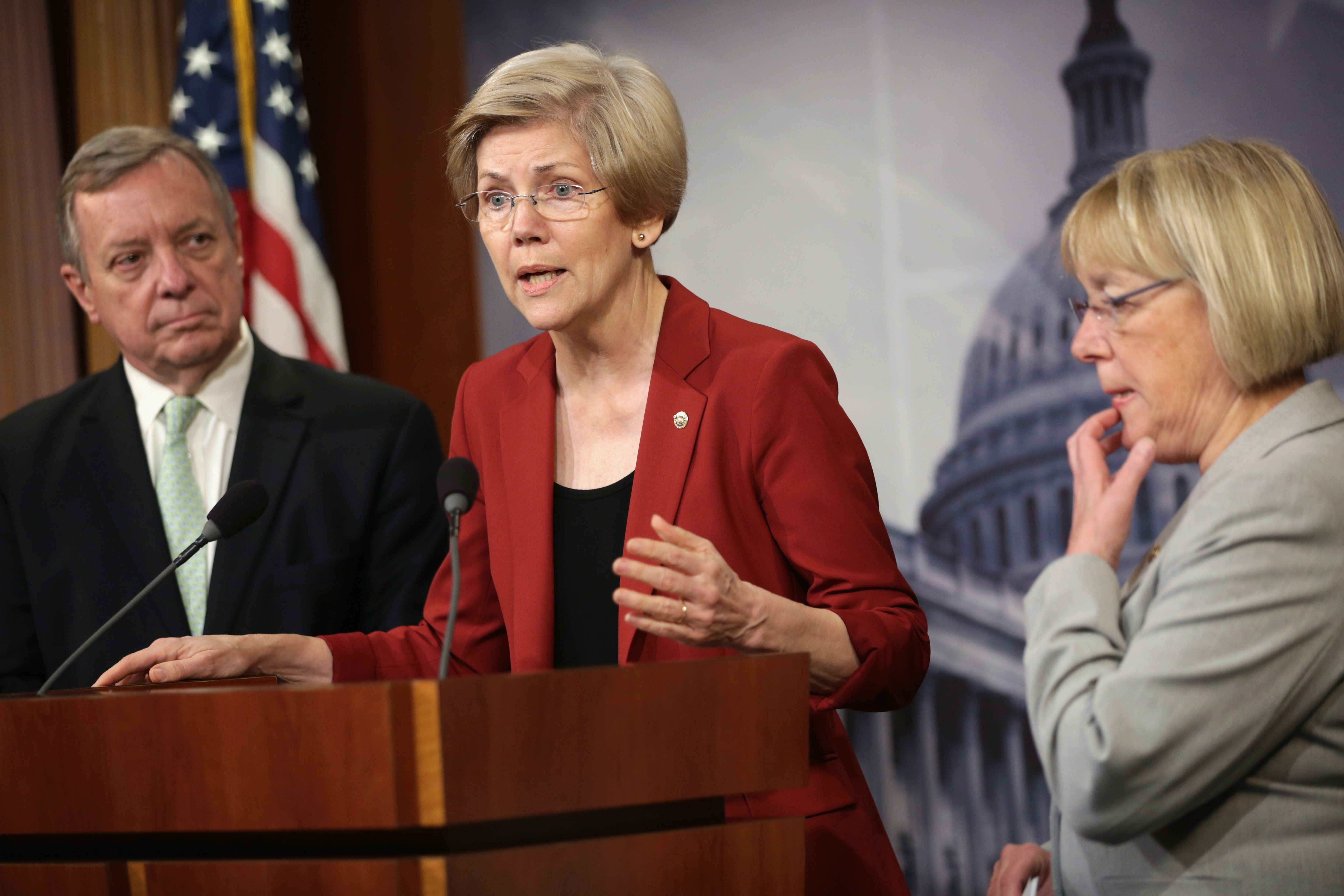 WASHINGTON, DC - JUNE 05:  U.S. Sen. Elizabeth Warren (D-MA) (2nd L) speaks as Senate Majority Whip Sen. Richard Durbin (D-IL) (L), and Sen. Patty Murray (D-WA) (R) listen during a news conference June 5, 2014 on Capitol Hill in Washington, DC. Senate Democrats held the news conference to discussion college affordability.  (Photo by Alex Wong/Getty Images)