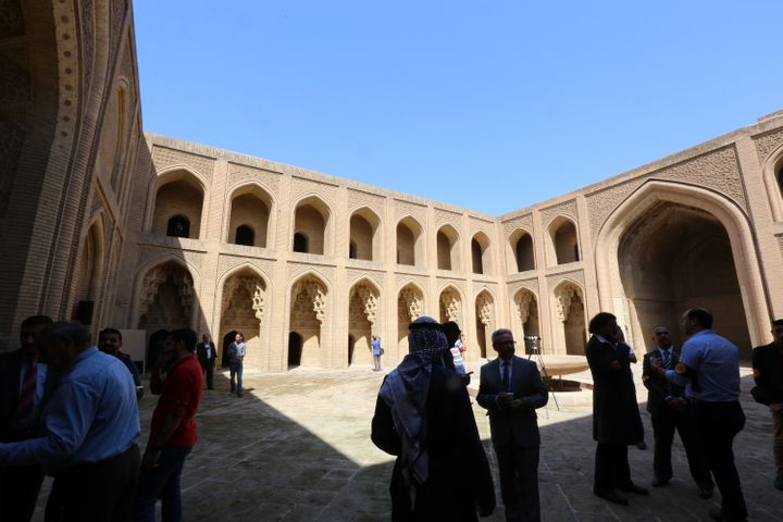 A picture taken on March 12, 2016 shows visitors at Qasr al-Abbasi Palace in the al-Maiden neighbourhood of Baghdad during a