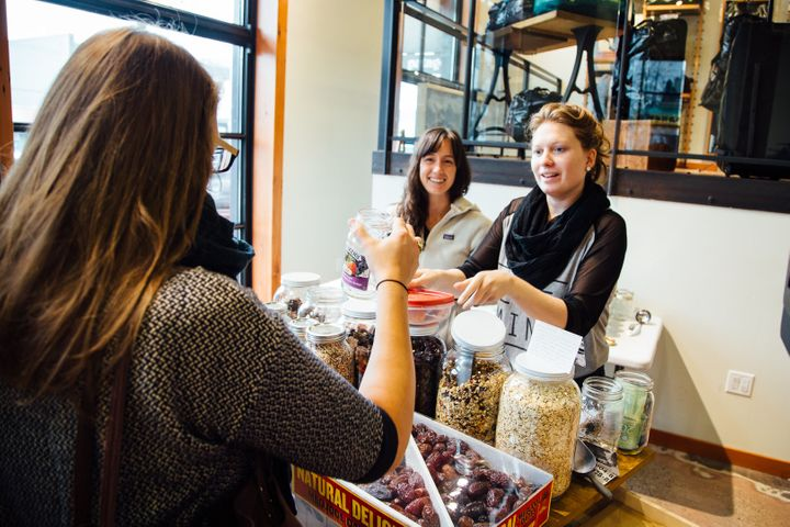 Shoppers can use their own glass jars to scoop out dry goods at Zero Waste Market in Vancouver, Canada.