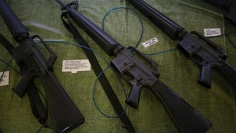 Vietnam era M-16 rifles are displayed for sale at a vendor's booth during the Fall 2015 Knob Creek Machine Gun Shoot in West Point, Kentucky, U.S., on Friday, Oct. 9, 2015. The Machine Gun Shoot is a three day bi-annual event that attracts gun dealers, collectors, and enthusiasts from all across America in what is considered one of the largest gun shows in the world dealing specifically with high caliber weaponry. Photographer: Luke Sharrett/Bloomberg via Getty Images