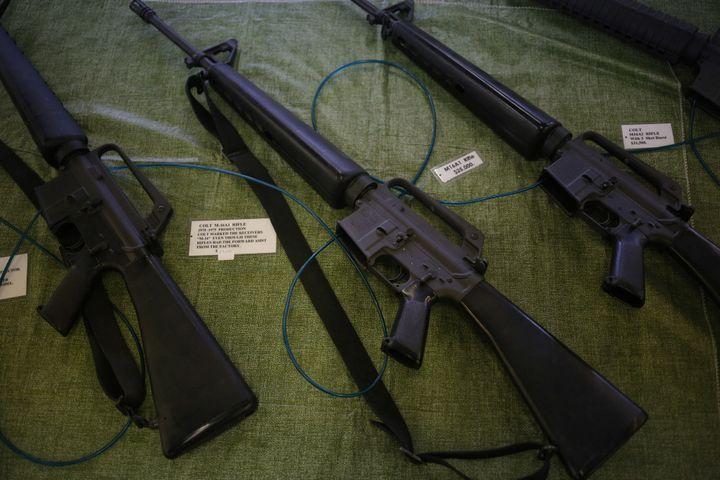 Vietnam War-era M16 rifles displayed at a vendor's booth during the Knob Creek Machine Gun Shoot in West Point, Kentucky, on