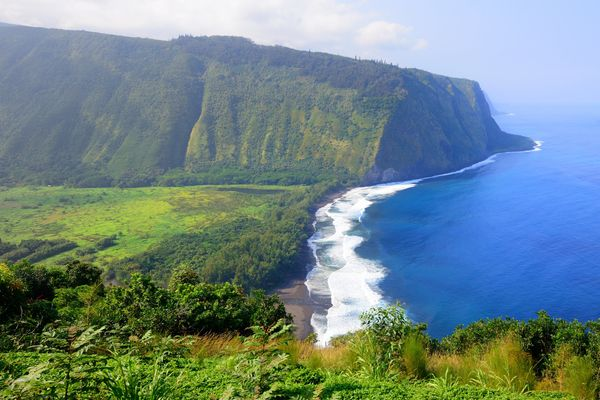 This deep valley is lush and expansive -- and its black sand beach is a majestic touch. (The Big Island)