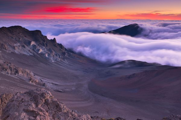 Sit above the clouds more than 10,000-feet in the skybefore dawn, because watching the sunrise over a volcano will set