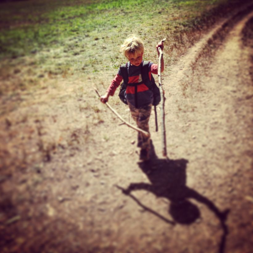 "<a href=""http://365outside.org/junior/"" target=""_blank"">Junior</a> wanders the woods with a set of walking sticks."