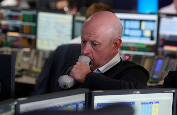 A trader from BGC Partners, a global brokerage company in London's Canary Wharf, waits for European stock markets to open early June 24after Britain voted to leave the European Union.