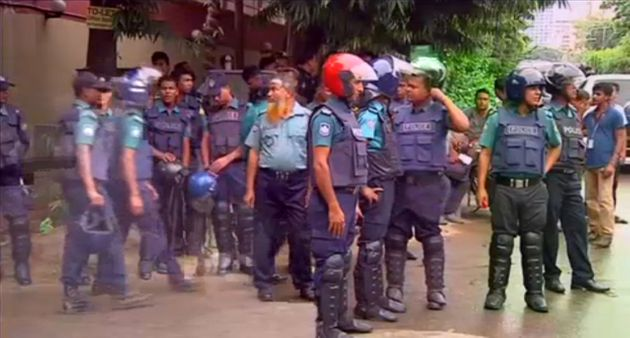 Police outside the restaurant where gunmen took hostages early on Saturday, in Dhaka,