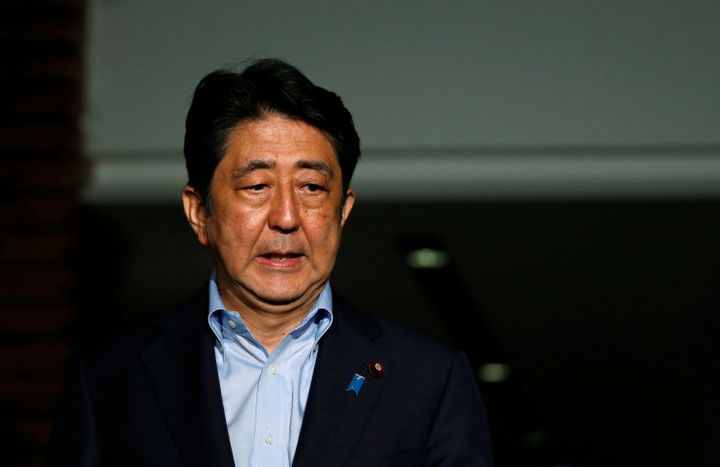 Japan's Prime Minister Shinzo Abe reacts as he speaks to the media at the Prime Minister's official residence in Tokyo, Japan