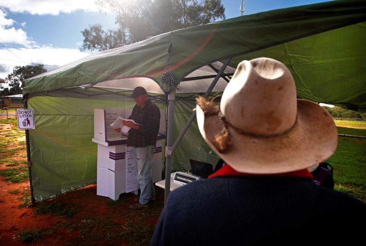 Peoplevote in the remote pollingstation in the western New South Wales outbacklast week. With half the vote
