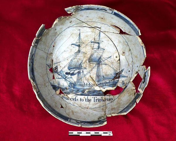 """A punch bowl reading """"Success to the Tryphena"""" features a ship that the colonists usedin the 1700s."""