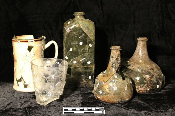 These tankards and wine bottles are believed to have come from a home on Carter's Alley.
