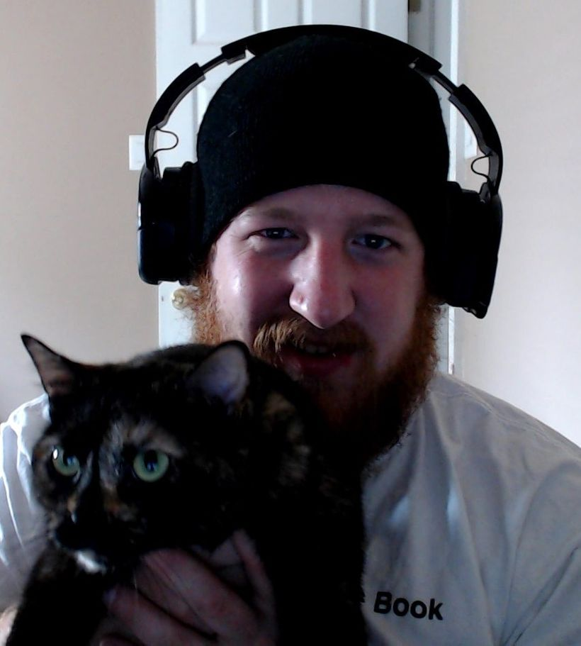 "My husband Chad with his ""gamer"" cat Amelia"