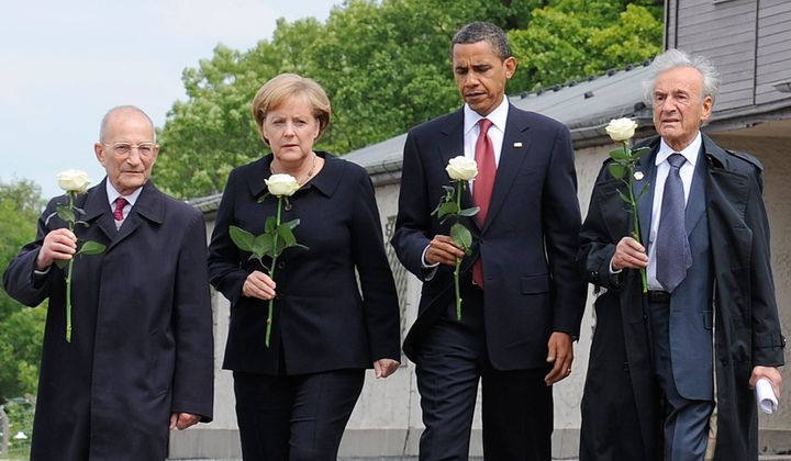 Wiesel is pictured here with U.S. President Barack Obama, German Chancellor Angela Merkel, and fellow Holocaust survivor