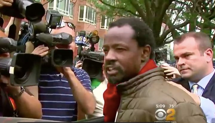 Ekwan Hill, 42, is seen speaking to reporters after his arrest for allegedly attacking two women with feces Monday.