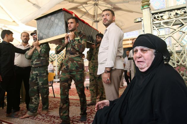 Mourners carry the coffin of their relative, who was killed in a suicide vehicle bomb in the Karrada...