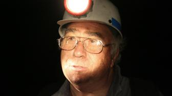 Robert Murray, founder and chairman of Cleveland-based Murray Energy Corp., looks on during a tour of the the Crandall Canyon Mine near the block tunnel where six coal miners are trapped, northwest of Huntington, Utah August 8, 2007. Six miners remained trapped deep underground on Wednesday, more than two days after a Utah mine collapsed, as special drills inched slowly toward the chamber where the men were thought to be. REUTERS/Rick Bowmer/Pool  (UNITED STATES)