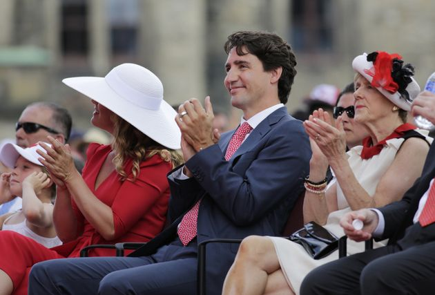 Justin Trudeau, Canada's prime minister, right, and wife Sophie Gregoire Trudeau, left, applaud during...