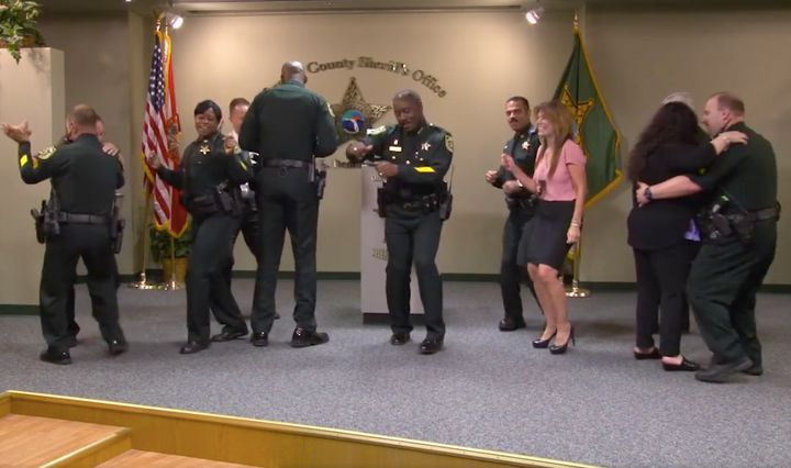 Orange County Sheriff Jerry Demings breaks into dance with his staff after calling a press conference.