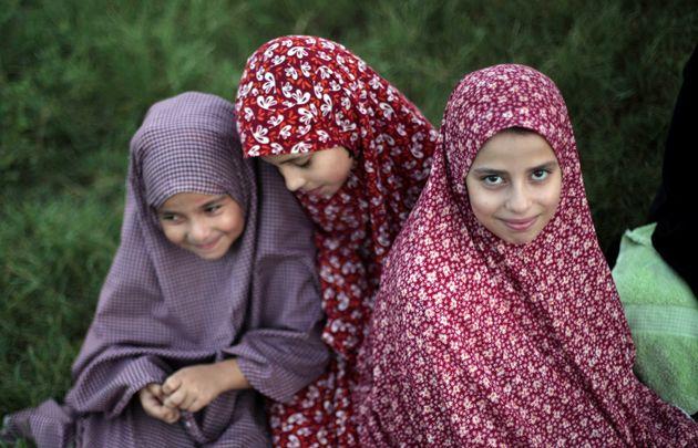 Veiled Palestinian girls attend Eid prayers in Gaza City,