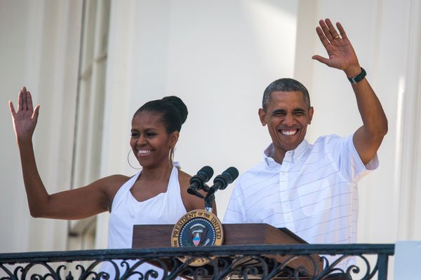 The president and first lady wave from the South Portico to U.S. veterans and their families, as well as White House sta