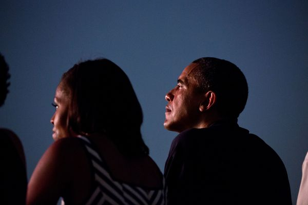 The president and first lady watch from the White House roof as fireworks erupt over the National Mall on July 4, 2012.