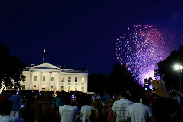 A crowd watches as fireworks explode over the White House on July 4, 2013.