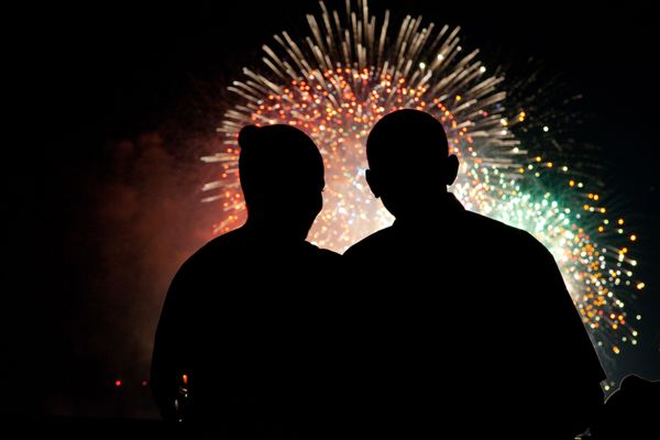 President Barack Obama and first lady Michelle Obama watch the fireworks over the National Mall from the White House on July