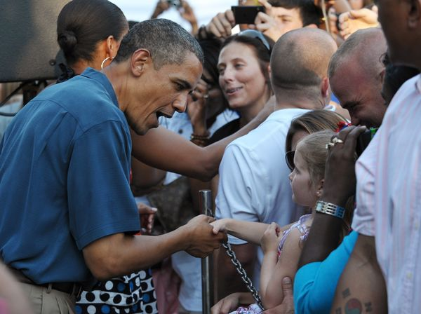 Obama greets guests during a Fourth of July barbecue for military members, government employees and their families in 20