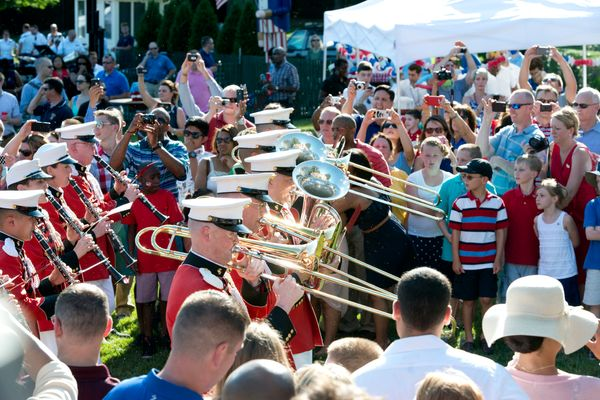 The United States Marine Band marches through the crowd prior to the president's remarks at a Fourth of July barbecue on