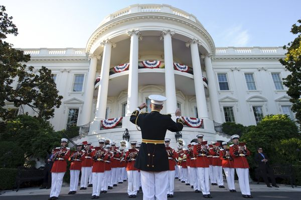The Marine Band performs at a Fourth of July barbecue hosted by the president and first lady for military members and fa