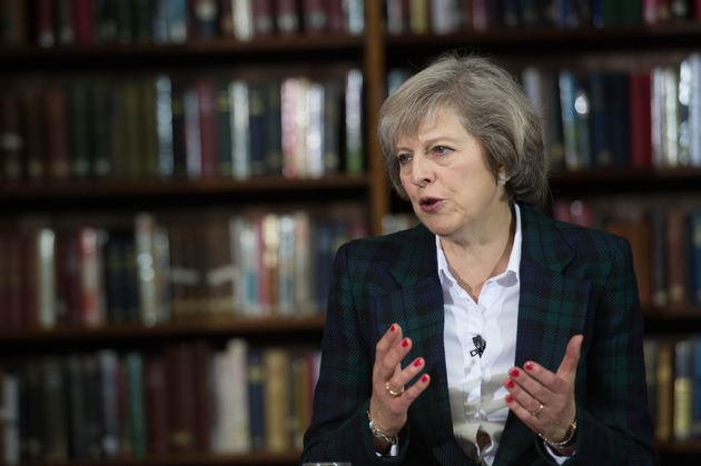 Theresa May Accused Of 'Threatening' EU Nationals With