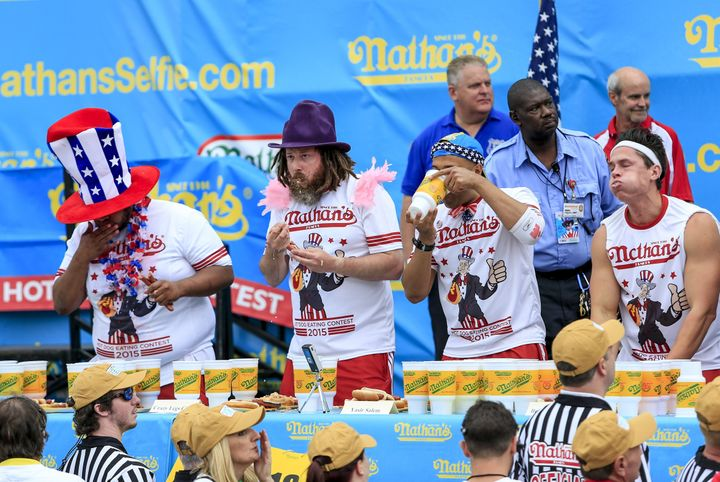 Competitors are seen during Monday's hot dog eating contest in New York on Monday.