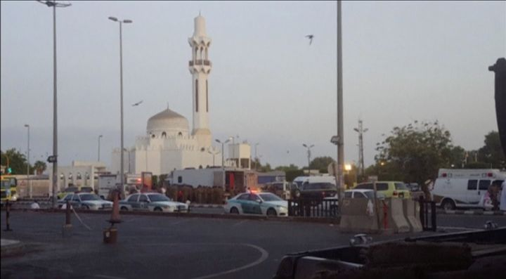 General view of security personnel in front of a mosque as police stage a second controlled explosion near the U.S. consulate