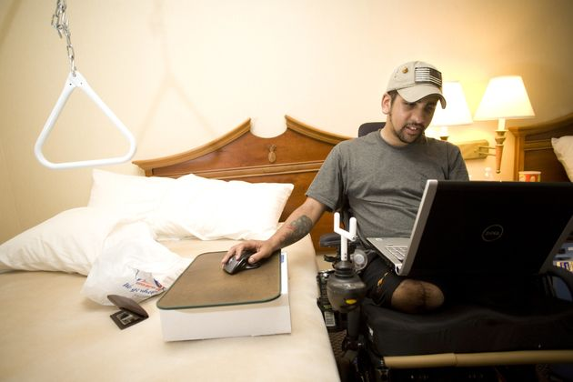 Iraq war veteran SGT Luis Rosa-Valentin, who lost both of his legs, left arm and hearing while serving...