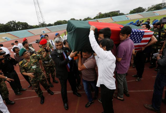 Relatives carry the coffin of a victim who was killed in the attack on the Holey Artisan Bakery and the...