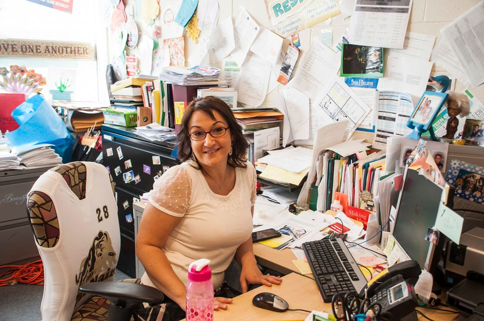 Maggie Sleman, the school's guidance counselor and anti-bullying specialist, poses in her office which turns into a safe spac