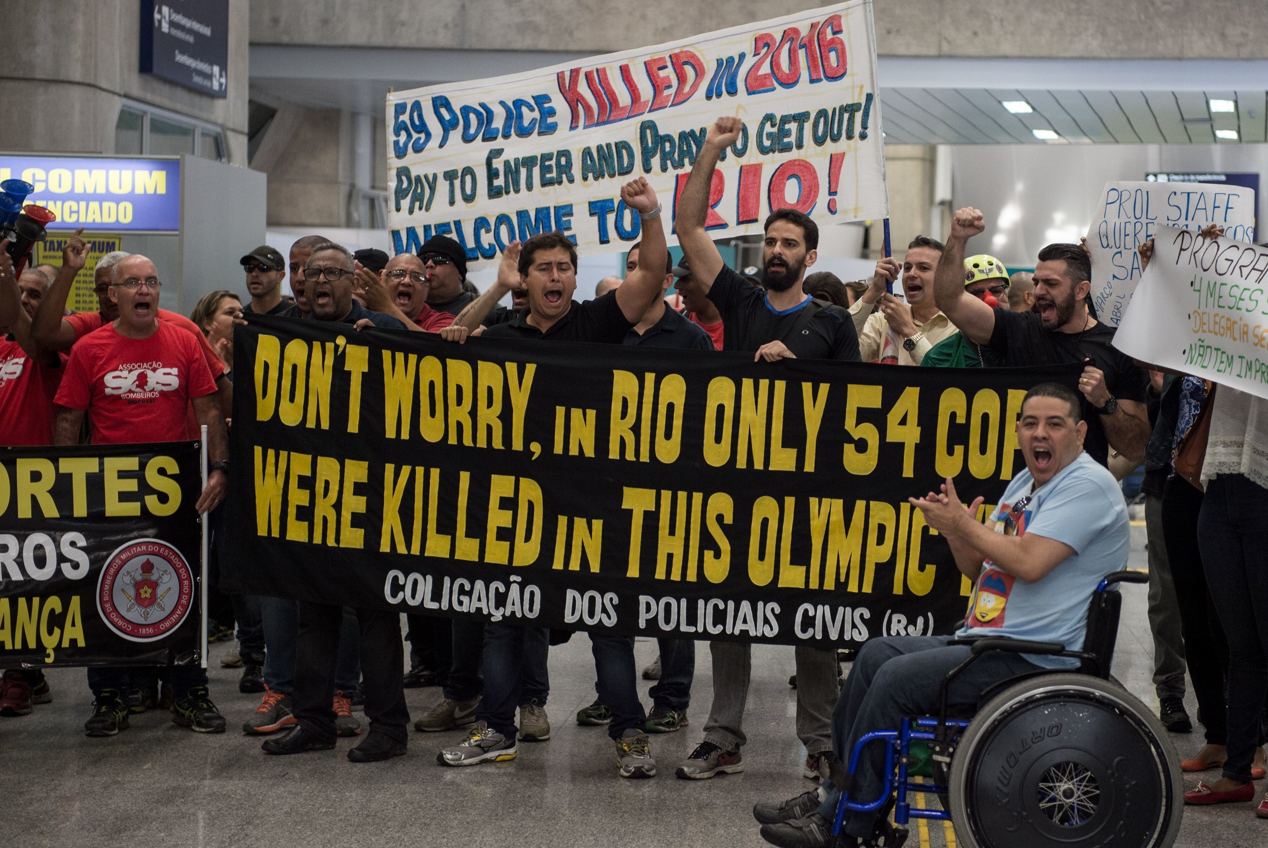 On Monday, July 4, 2016, Rio police officers and firemen protested at the local airport after not receiving...