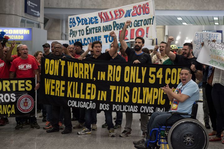 On Monday, July 4, 2016, Rio police officers and firemen protested at the local airport after not receiving several months' p