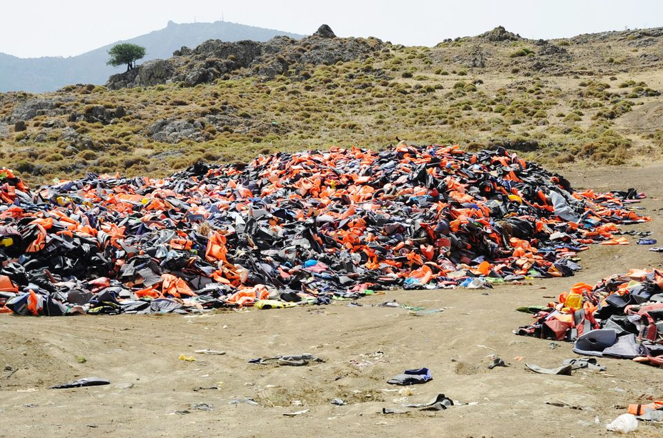 The lifejackets and wrecked boats that once dotted the Lesbos coastline are now piled up out of sight...