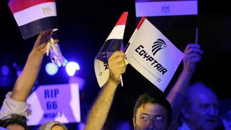 People hold EgyptAir flags during a candlelight vigil for the victims of EgyptAir flight 804, at the Cairo Opera House in Cairo, Egypt May 26, 2016. REUTERS/Mohamed Abd El Ghany