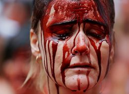 Activists Strip And Splash Themselves With Fake Blood In Pamplona