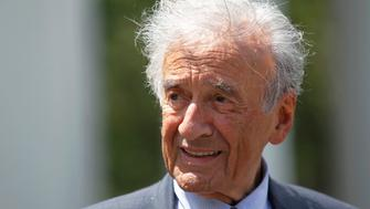 Writer, Nobel Laureate and holocaust survivor Elie Wiesel speaks to the media outside the West Wing of the White House in Washington, DC, U.S. on May 4, 2010, following a private lunch with U.S. President Barack Obama.      REUTERS/Jason Reed/File Photo
