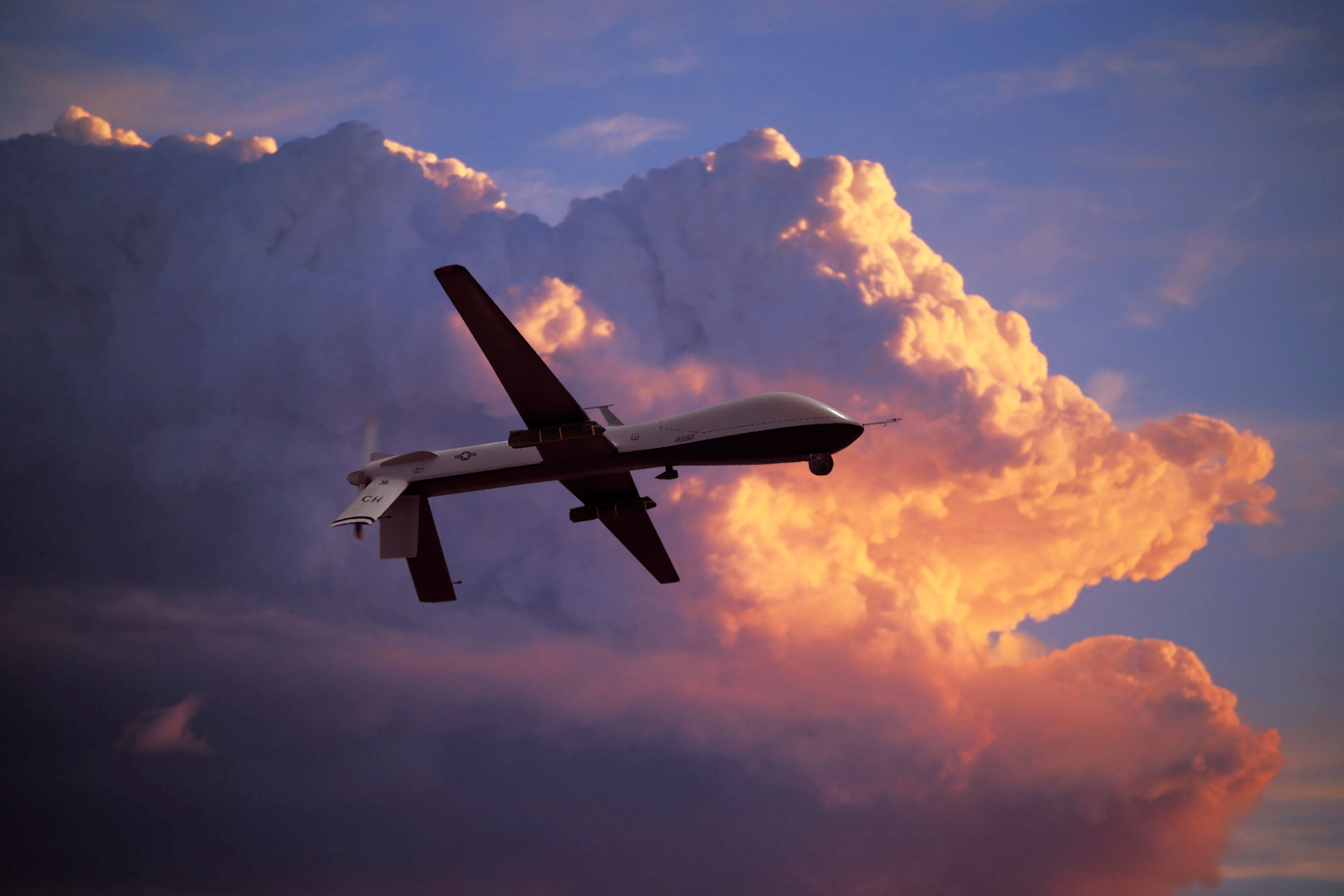 Unmanned MQ-1 Predator with Hellfire missiles at Sunset